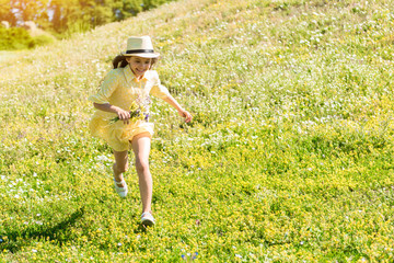 Cheerful child having great time on grassland