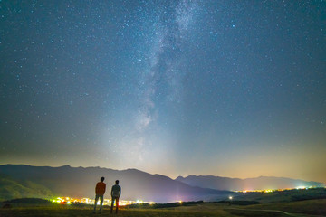 The two friends stand on the background of the stars. night time