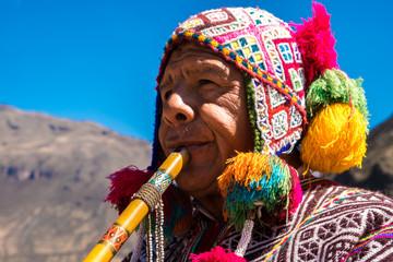 Peruvian man playing a flute, Sacred Valley, Cusco, Peru