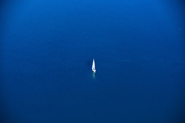 lonely sailor on deep blue water