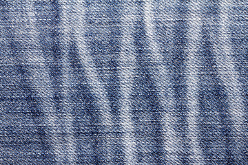 Close up the denim bright  blue jeans surface with rag patten texture background