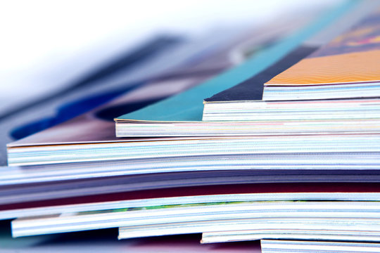 stack of colorful magazines , extreamly DOF