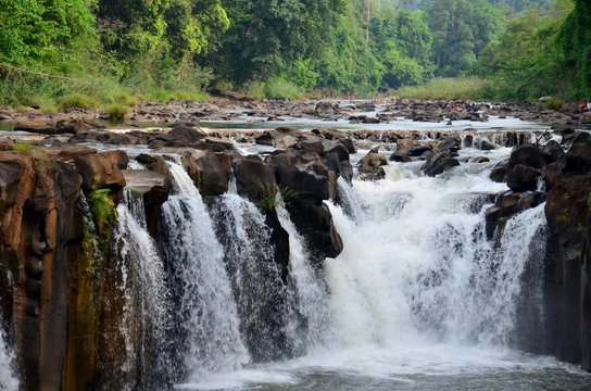 Motion and flowing water of Tad Pha Suam waterfall