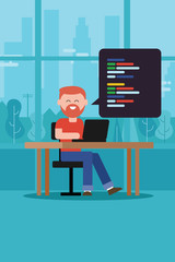 coding programming script man with beard t-shirt sitting working on laptop on table