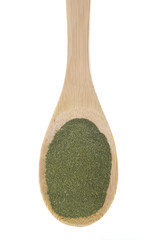 Moringa powder on a bamboo spoon.
