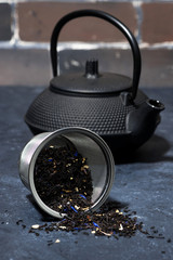 black cast iron kettle and dry tea