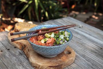 Raw salmon poke bowl with rice