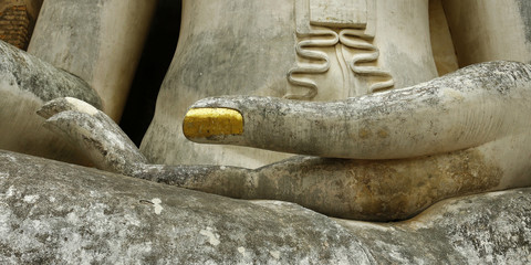 Detail hand of statue of buddha,in the historical park of Sukhothai,Thailand