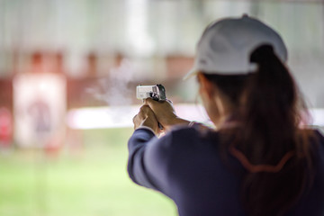 gun holding in hand of woman in practice shooting in martial arts for self defense in an emergency case