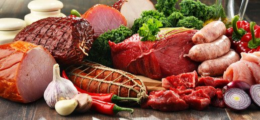 Photo sur cadre textile Viande Variety of meat products including ham and sausages