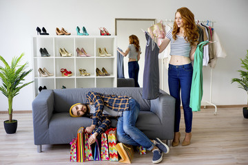 Bored man shopping with his girlfriend