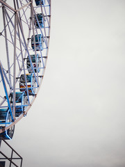 Ferris wheel, grey sky background
