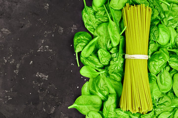 Spaghetti with spinach  on a background of leaves