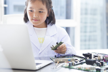 The girl is studying computer parts