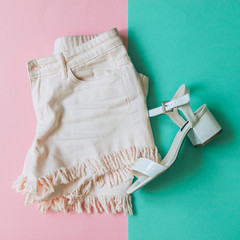 shorts with fringe and white patent leather sandals with wide heel. minimal style. festival concept