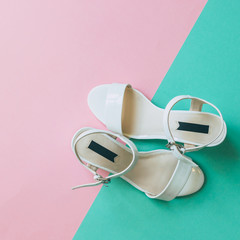 festival fashion shoes for women: white patent leather sandals. minimal trend. double background.