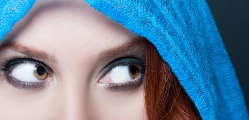 Closeup view of young female smokey eyes