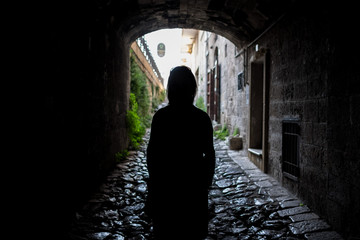 silhouette of girl in tunnel
