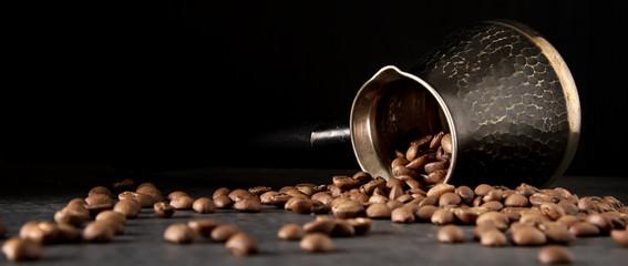 Italian coffee grains in turk. Delicious aromatic drink. Dark ba