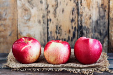 Apples fresh on the old wooden.