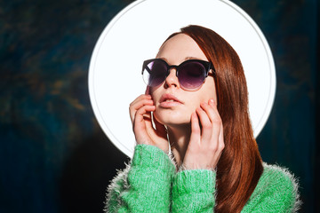 young redhead girl in sunglasses