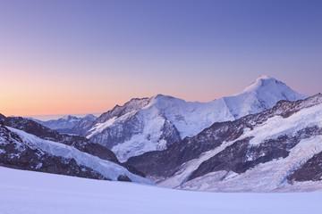 Fototapete - Dawn at Jungfraujoch in Switzerland