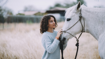 Attractive woman with a horse outdoor