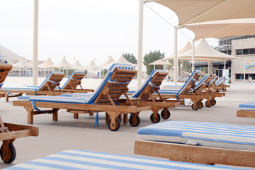 Swimming pool and deck chairs at the resort. United Arab Emirates
