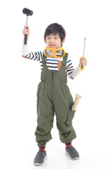 Cute Asian child with construction tools