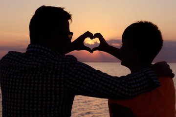 Date of two lovers of adolescents on the beach (ocean). Love, romance and tenderness