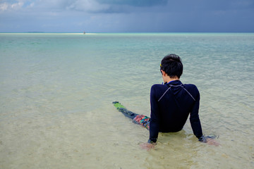man relaxing at beach of Taketomi