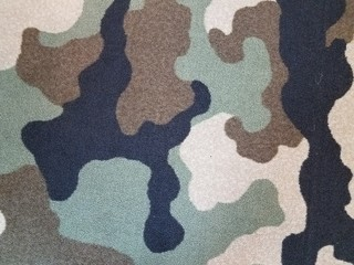 black, tan, and green camouflage carpet