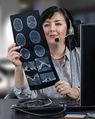 Telemedicine doctor in front of computer monitor