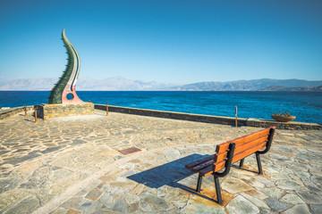 Cornucopia statue also known as the Horn of Amalthea at the waters edge, Agios Nikolaos, Crete, Greece, Europe