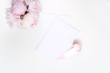 Wedding card with pink peonies. Flat lay.