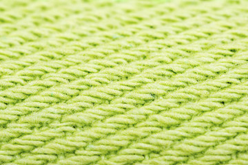 Green cotton fabric texture background.