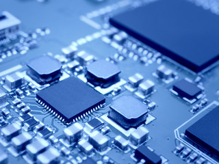 Closeup image of microprocessor on electronic circuit board. Blurred and toned image. Shallow DOF.