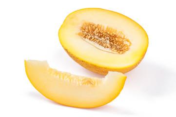 Slice of ripe yellow melon, on white