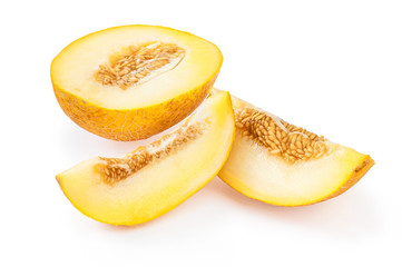 Slices of ripe yellow melon with seeds, on white background