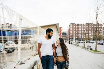 Charming couple walking at street