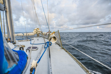 Sailing boat deck sailing on a North sea in cloudy day.