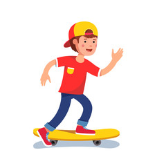 Teen boy in baseball cap riding on skateboard