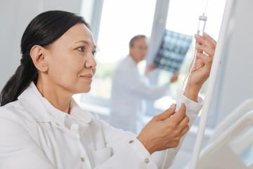 Smart professional nurse pressing the button