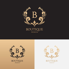 Boutique brand logo template. Vector symbol with crown and floral ornament. Logotype for uses in fashion spheres, hotel and restaurant business and jewelry industry.