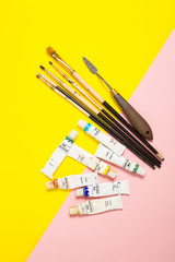 Paints brushes pencils paper colors mock up