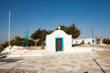 Little white chapel on the hill. Small church in Faliraki, Greek town on the island of Rhodes.