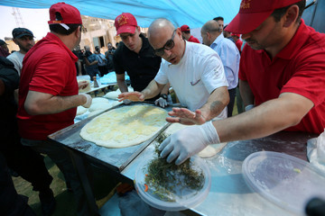 An Italian chef prepares pizzas for Palestinians during a food and cultural exchange event at the seaport of Gaza City