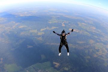 Skydiver girl in the sky