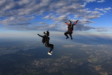 Two skydiver girls in the sky