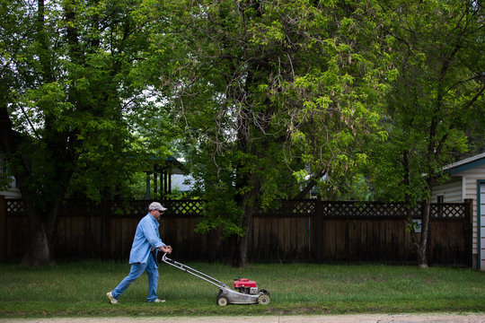 Man mows his lawn as residents return to Fort McMurray, Canada